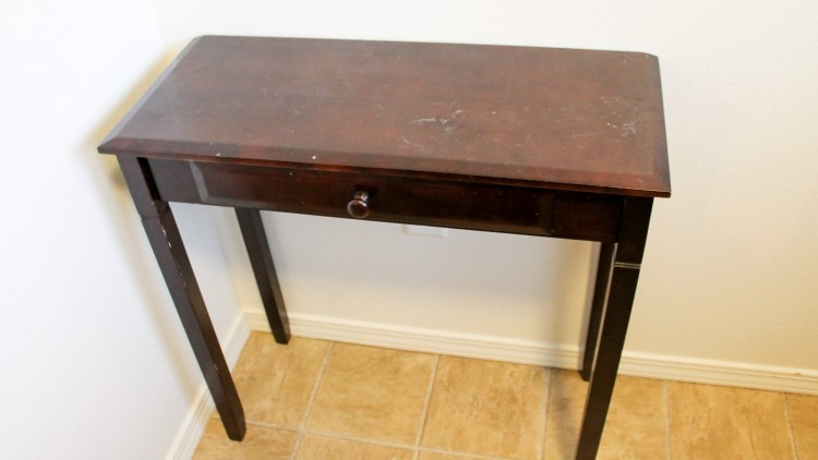 Take an old console table and turn it into a lap top desk, or even a vanity