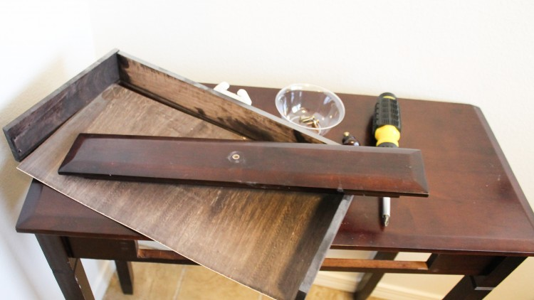 Check out the remake of this old console table. Especially love what she does with the drawer!