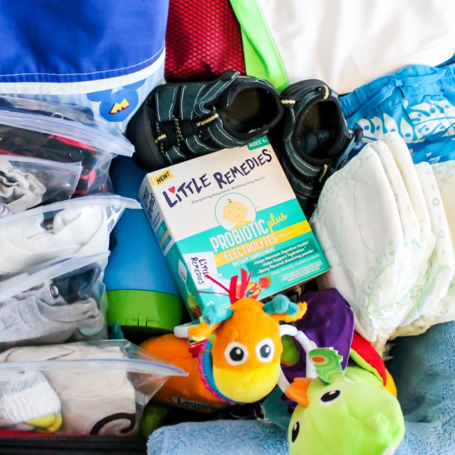 Packing for babies and toddlers- what to put in the suitcase, what to have in a carry-on or up ront in the car.