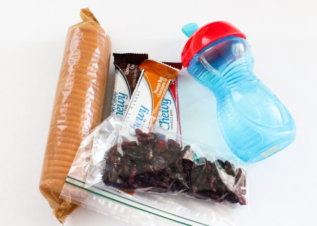 Don't forget easy to grab snacks for you and your little ones while flying. Snacks are a great way to keep a baby or toddler occupied and happy when in a plane or airport lobby.