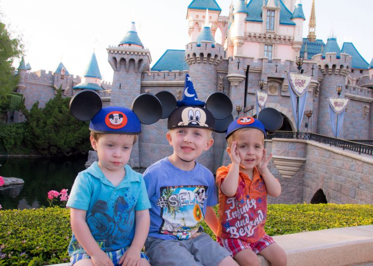 Child lost at Disney, boys in front of Disneyland castle