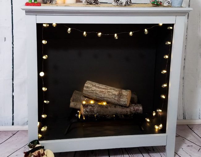DIY bookshelf to faux fireplace is an awesome solution for renters