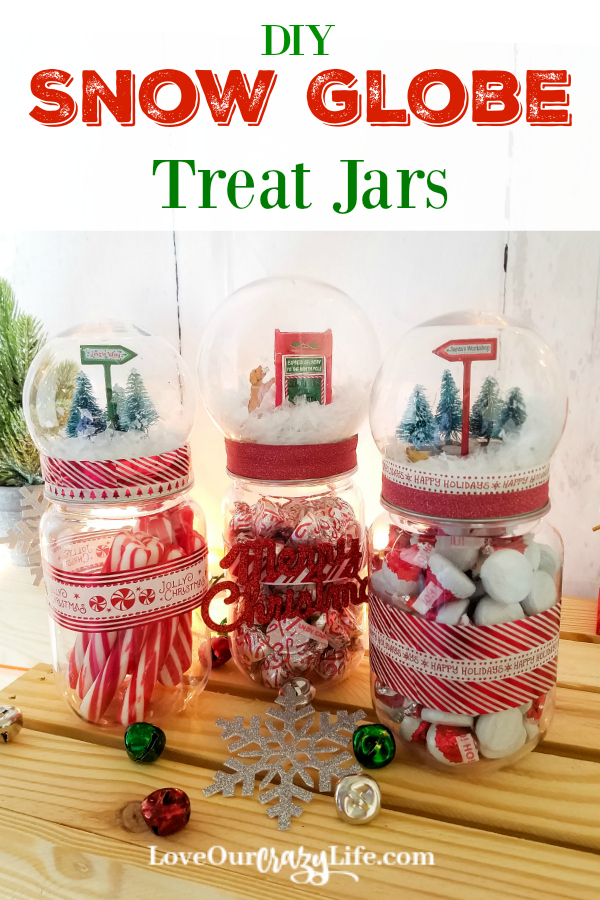 DIY Snow Globe Treat Jars made using mason jars are a great Christmas craft. Check out this fun holiday DIY. Makes a great gift for teachers, neighbors, and more. Or use it as a decoration plus goodie jar in your home. #holidays #DIY #Craft  #ThisCrazyAdventureCalledLife
