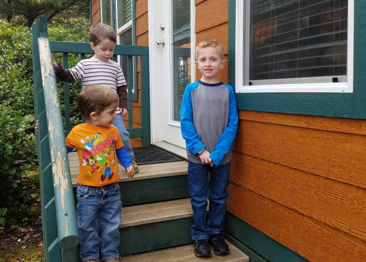 kids on cabin porch at RV Park