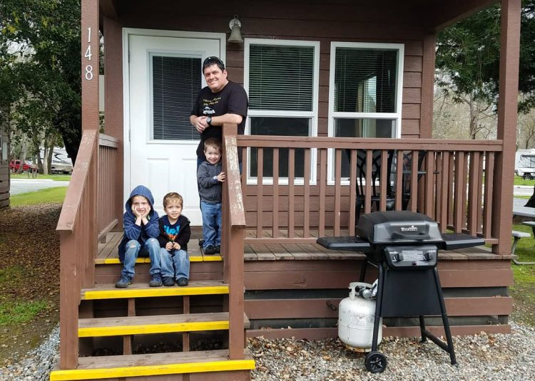 family in front of cabin at RV park