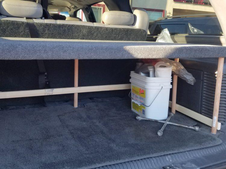 Preparing car for road trip. Suburban shelf