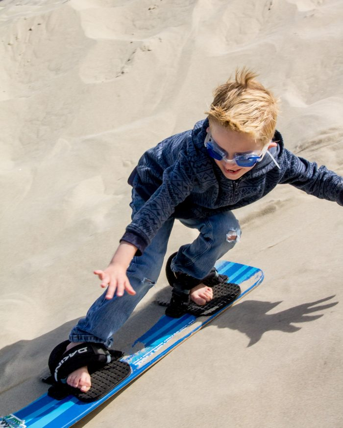 Sandboarding is a great family activity near Florence, Oregon