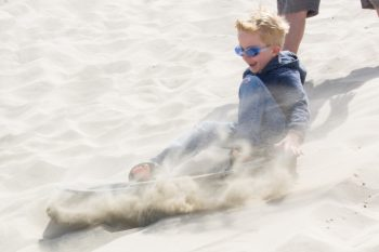 Sandboarding is a great family activitiy in Florence Oregon