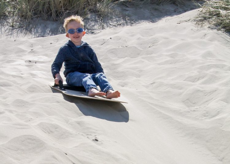 Sand Sledding is a fun family activity near Florence, Oregon