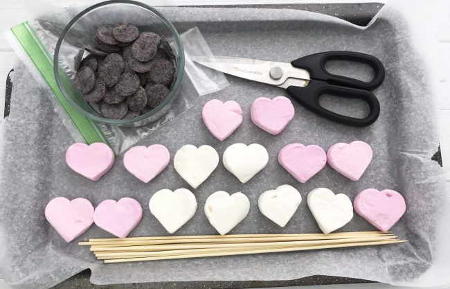 Ingredients and supplies to make heart marshmallow stirrers