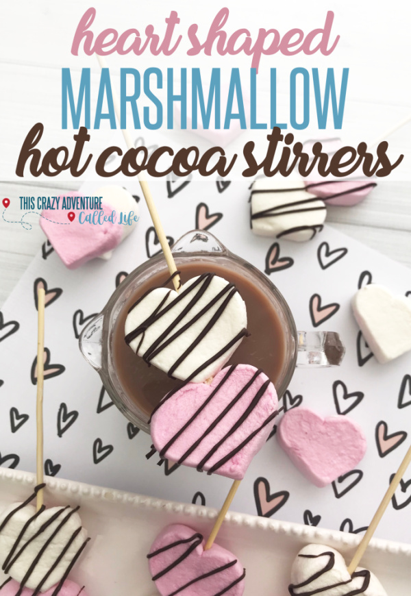 These heart shaped marshmallow hot cocoa stirrers are the perfect Valentines Day treat for kids and parents alike. Also great for a cute addition to your breakfast year round. Valentines day hot cocoa isn't complete without heart shaped food so these easy DIY marshmallow stirrers are the answer! #Valentines #hotchocolate #Marshmallow #ThisCrazyAdventureCalledLife