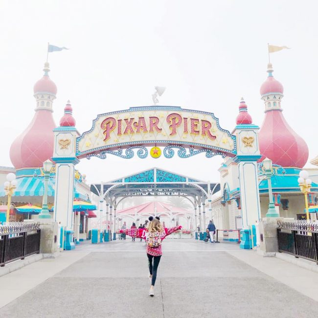 girl skipping into Pixar Pier at Disneyland Resort Photopass location