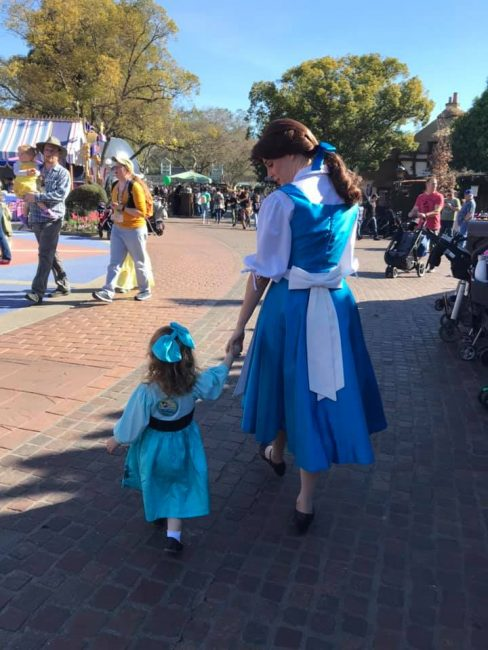 Disneyland photo toddler walking with Belle