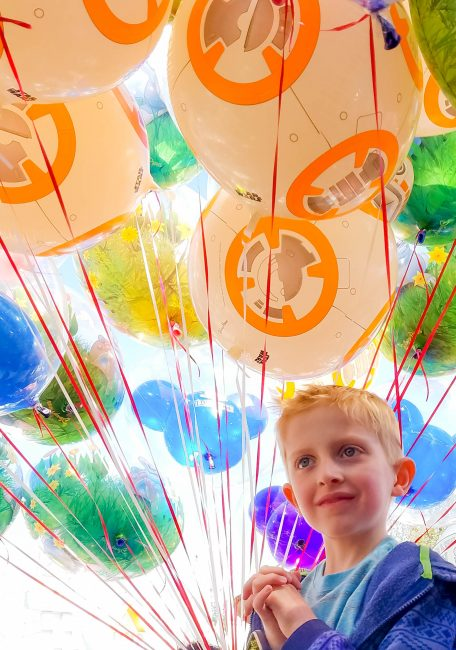 Child with Disneyland balloons in photo