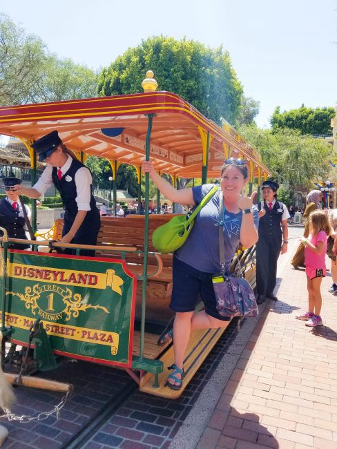 woman on Disneyland trolley