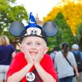 Kid wearing Mickey Mouse ears excited