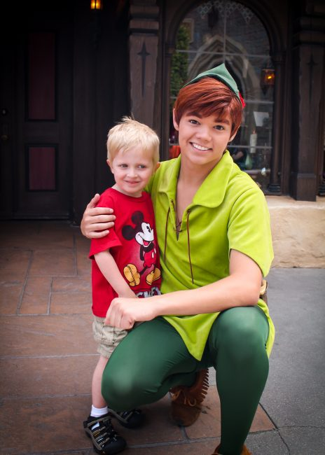 Toddler with Peter Pan in a Disneyland photo