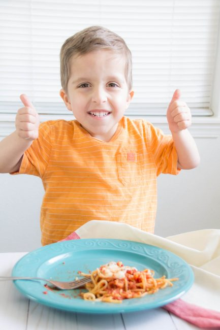 Kid double thumbs up after trying new food