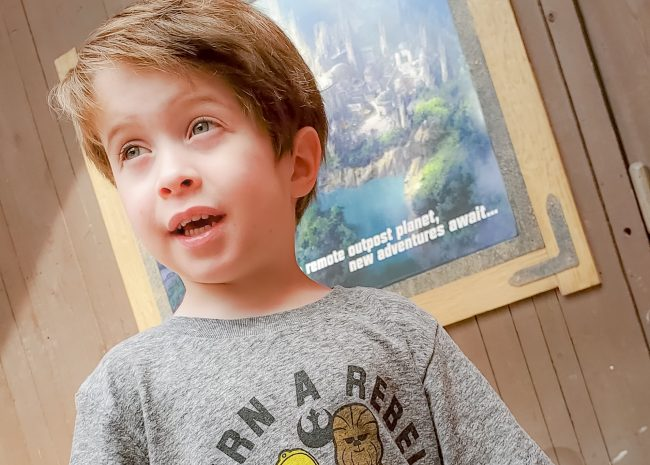 young boy at future entrance to Star Wars Land at Disneyland
