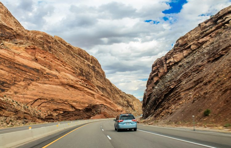 Car driving through Utah Red Rock Canyon