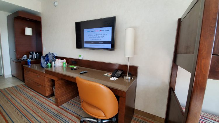 Desk and TV at Courtyard Theme Park Entrance Room