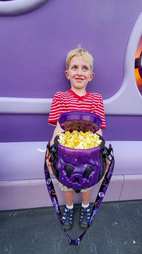 Disneyland Popcorn in caludron bucket held by boy